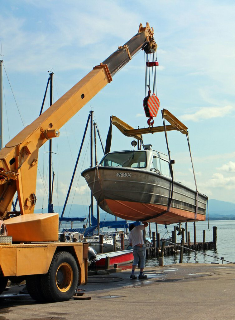 boat being lift up to get fixed