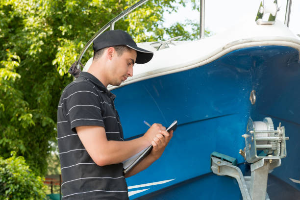 a guy writing the current status of the boat