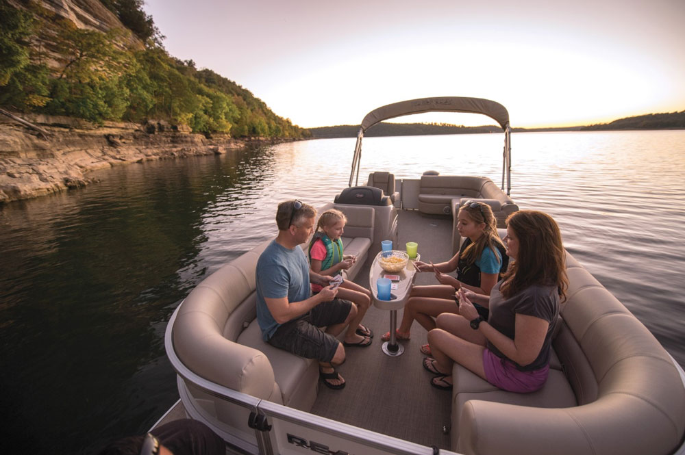Happy family at their newly bought used boat at San antonio texas